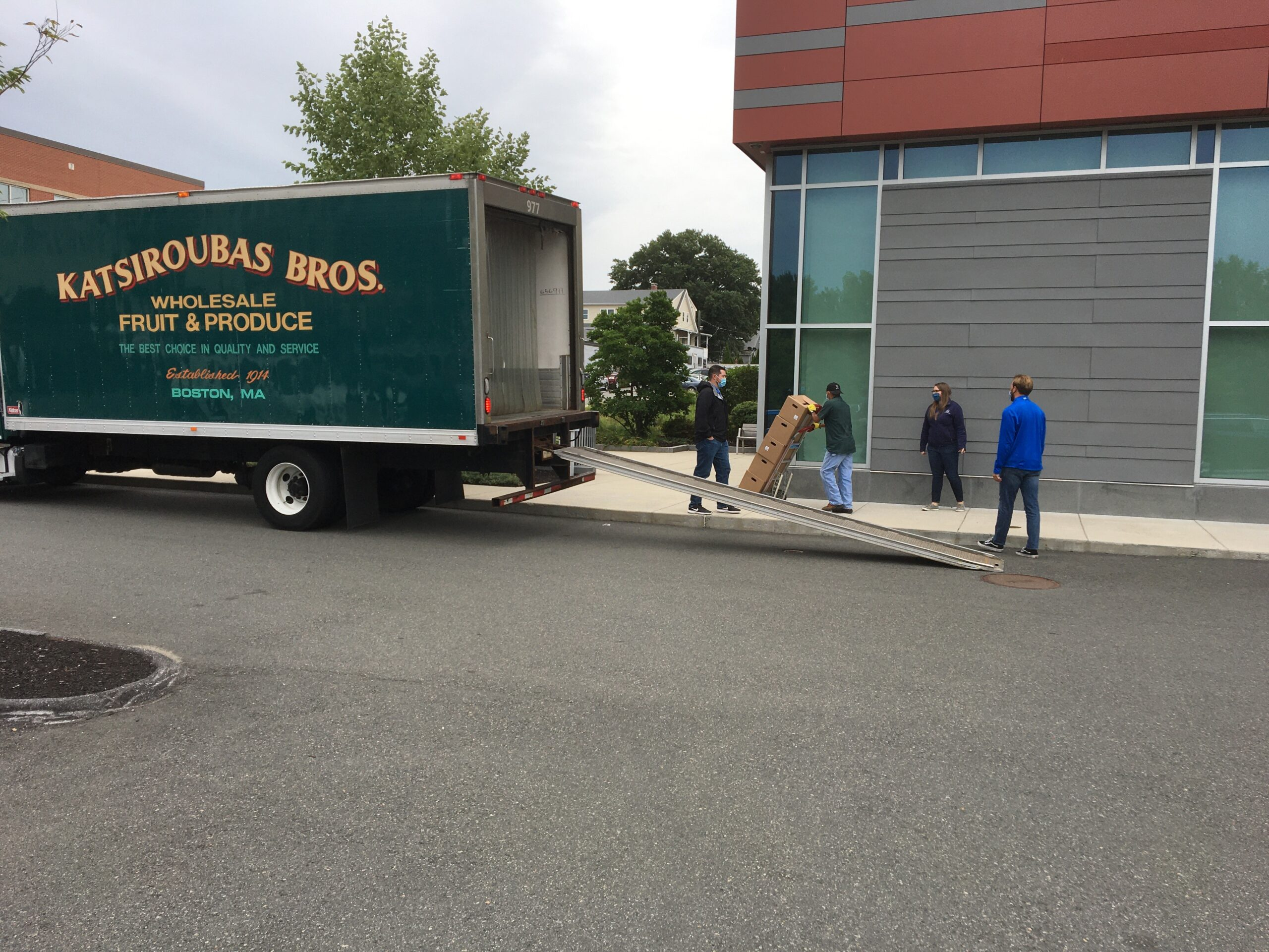 Newburg CPA Team charitable initiatives unloading produce boxes for those in need